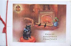 CHEERY CHRISTMAS GREETINGS at base, lighted room with black cat sitting left & 2 puppies before fire