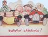 BIRTHDAY GREETINGS! in red, boy & girl drive cars side-by-side