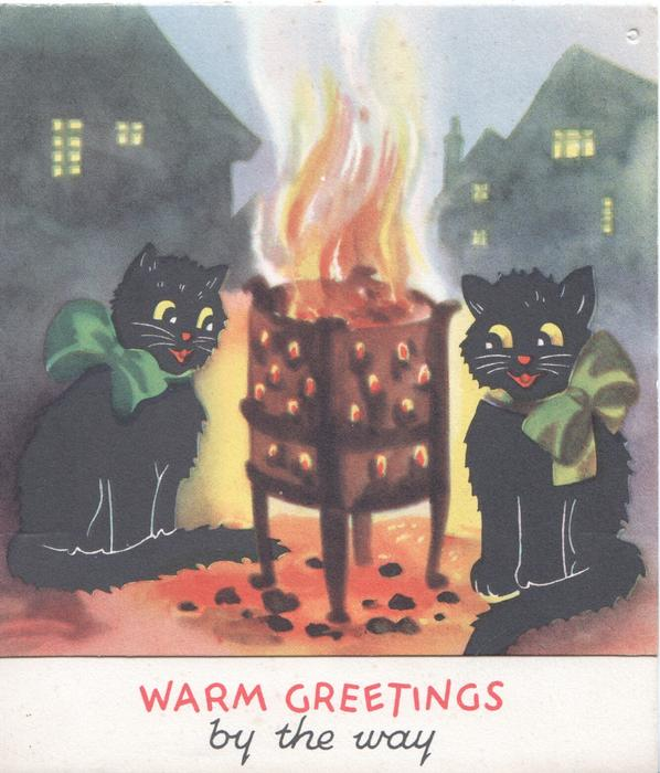 WARM GREETINGS in red BY THE WAY 2 black cats sit by  flaming brazier
