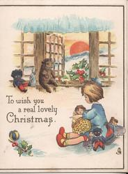 TO WISH YOU A REAL LOVELY CHRISTMAS girl sitting by window holding various toys