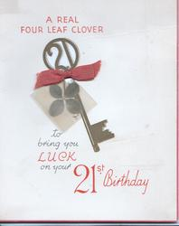 A REAL FOUR LEAF....21 key & real leaf in cellophane tied with ribbon