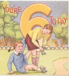 YOU'RE 6 TO-DAY above boy adjusting girls roller skates
