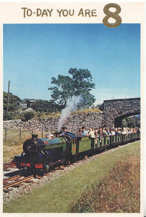 TO-DAY YOU ARE 8 in gilt, above inset of miniature steam train moving let, blue sky