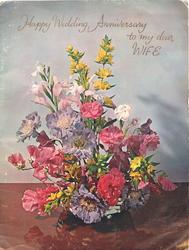 HAPPY WEDDING ANNIVERSARY colourful bowl of anemones, carnations, iris., lilies,sweetpeas & others
