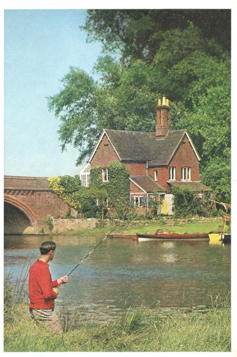no front title, man fishes with rod & line, bridge & house across riiver