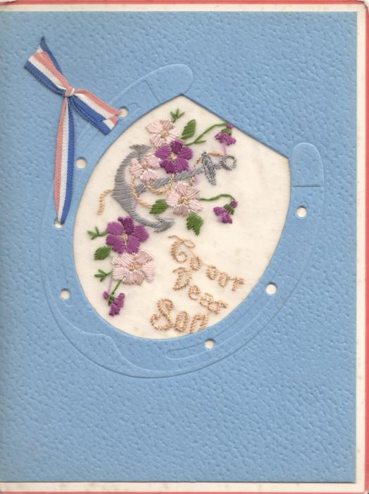 TO OUR DEAR SON on thin mesh in blue horseshoe below anchor & purple pansies