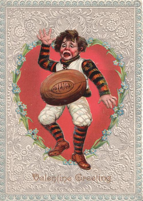 VALENTINE GREETING, THE FOOTBALL PLAYER  boy stands scared & open mouhed as football lands on him