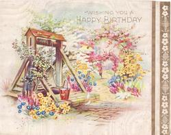 WISHING YOU A HAPPY BIRTHDAY well surrounded by flowers, path right