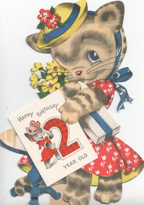 HAPPY BIRTHDAY 2 YEAR OLD. dressed kitten holding twice folded glued sheet
