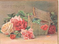 GREETINGS in pale gilt above pink red & yellow roses beside wicker basket