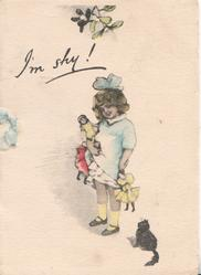 I'M SHY girl stand holding dolls facing half left looking front, black cat observes