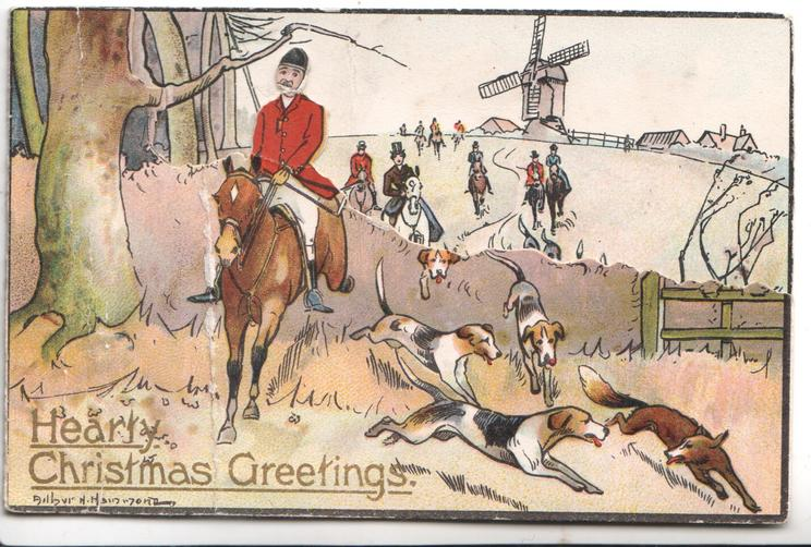 HEARTY CHRISTMAS GREETINGS in gilt below fox hunting scene, distant windmill