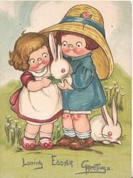 LOVING EASTER GREETINGS.  girl & boy feed a leaf to rabbit, another on ground