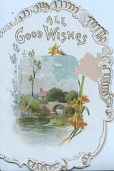ALL GOOD WISHES above bridge & river rural inset, yellow primroses below right, perforated gilt marginal designs