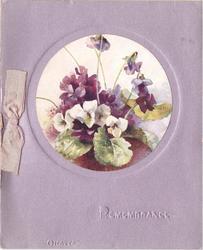 REMEMBRANCE impressed below circular inset of violets, metallic mauve background