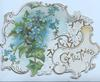 GREETINGS in gilt  on white inset lower right, ivy leaves & forget-me-nots left perforated design across card