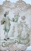 GREETINGS in green at base, man & woman walk away on either side of pedestal with flowers, gazing into each others eyes, elaborate design
