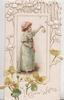 GOOD WISHES in gilt below inset of blonde girl standing holding light, facing right, perforated design above, buttercups below