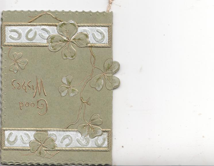 GOOD WISHES in gilt right, stylised clover left, white & grey horseshoe design top & bottom ,olive-green background