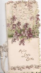 AULD LANG SYNE in gilt below purple heather & much perforated white design