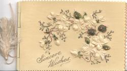 on celluloid front SINCERE WISHES below very heavily embossed branch of stylised white flowers, scant green leaves