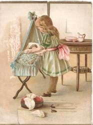 no front title, WITH LOVE AND GOOD WISHES(hidden, in gilt) girl bends over sister in blue cot