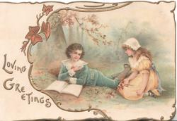 LOVING GREETINGS in gilt, boy in blue & girl in pink old style dress on ground in woodland clearing