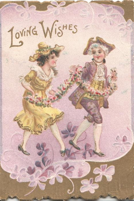 LOVING WISHES in gilt, boy & girl in old style dress dance holding a daisy chain, lilac background, violets below, gilt surrounding & marginal design