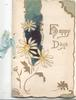 HAPPY DAYS in gilt, blue & gilt design with white daisies, cream  background