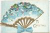 A GREETING in gilt, forget-me-nots in shape of fan, gilt support & printed blue bow