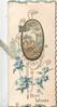 BEST WISHES at base, forget-me-nots below black & gilt bordered oval rural inset, house & tree, gilt design around