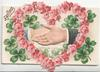 GREETINGS in gilt top left, male & female hands clasped within heart of pink roses