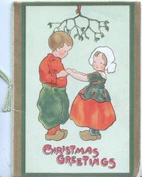 CHRISTMAS GREETINGS in red below dutch boy & girl holding hands beneath mistletoe
