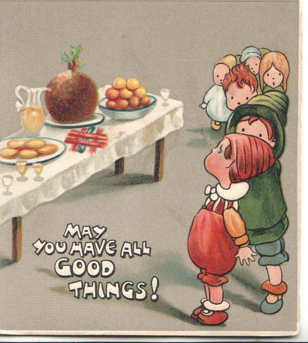 MAY YOU HAVE ALL GOOD THINGS! in white, 6 children line-up in front of table laden with Xmas fare