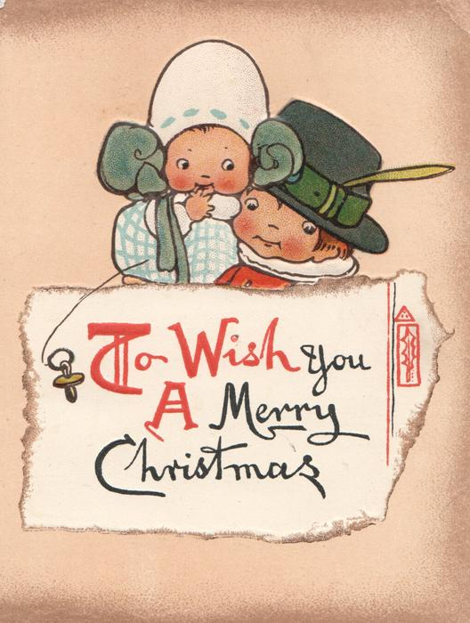 TO WISH YOU A MERRY CHRISTMAS below boy & girl behind white plaque