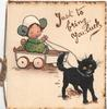 JUST TO BRING YOU LUCK above girl in cart with a doll pulled by black cat