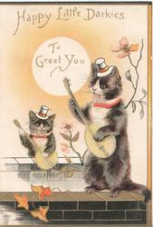 HAPPY LITTLE DARKIES TO GREET YOU 2 black cats sit up playing banjos