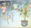 HAPPINESS BE YOURS vertically under 2 lanterns, pink roses in pot right