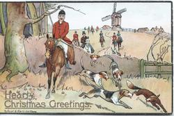 HEARTY CHRISTMAS GREETINGS in gilt below fox-hunting scene, many dogs, windmill at back