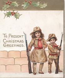 """TO PRESENT CHRISTMAS GREETINGS in gilt, girl & boy hold rifles & """"Present Arms"""", holly on gilt above"""