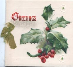GREETINGS in red top left, berried holly right