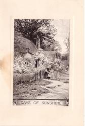 DAYS OF SUNSHINE mother & child stand at cottage gate, abundant flowering shrubs