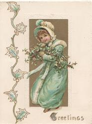 GREETINGS in gilt, inset girl in blue stands with armfull of berried holly, stylised holly left