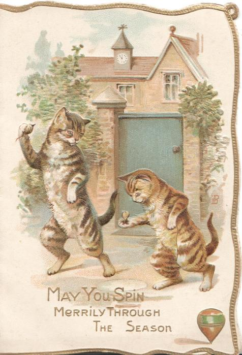 MAY YOU SPIN MERRILY THROUGH THE SEASON 2 cats stand erect holding spinning tops