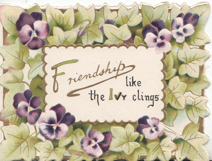 FRIENDSHIP LIKE THE IVY CLINGS on white plaque surrounded by ivy & purple/white pansies