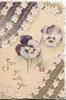 JOY GO WITH YOU in gilt on pale yellow ground below purple/white pansies, stylised floral & white designs top left & below right