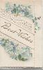 BEST WISHES on white plaque, perforated white design & forget-me-nots top & bottom