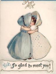 SO GLAD TO MEET YOU! two girls, wearing bonnets, embrace under gilt mistletoe, partial blue border