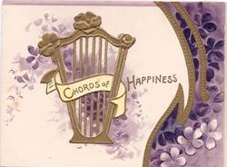 CHORDS OF HAPPINESS in gilt ribbon in front of gilt harp, purple violets to the right