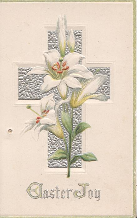 EASTER JOY in silver below Easter lilies that are in front of sillver cross